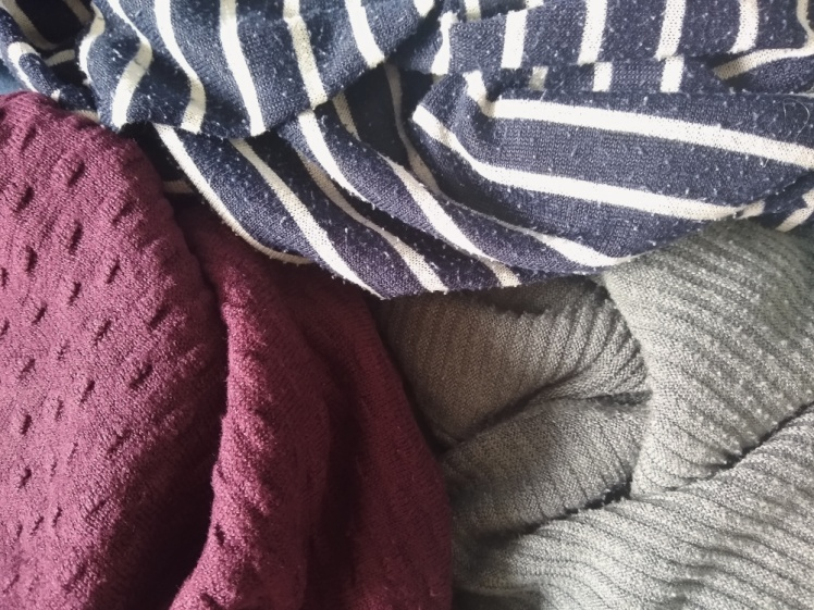 A navy/white-striped, burgundy and olive green colored fabric.
